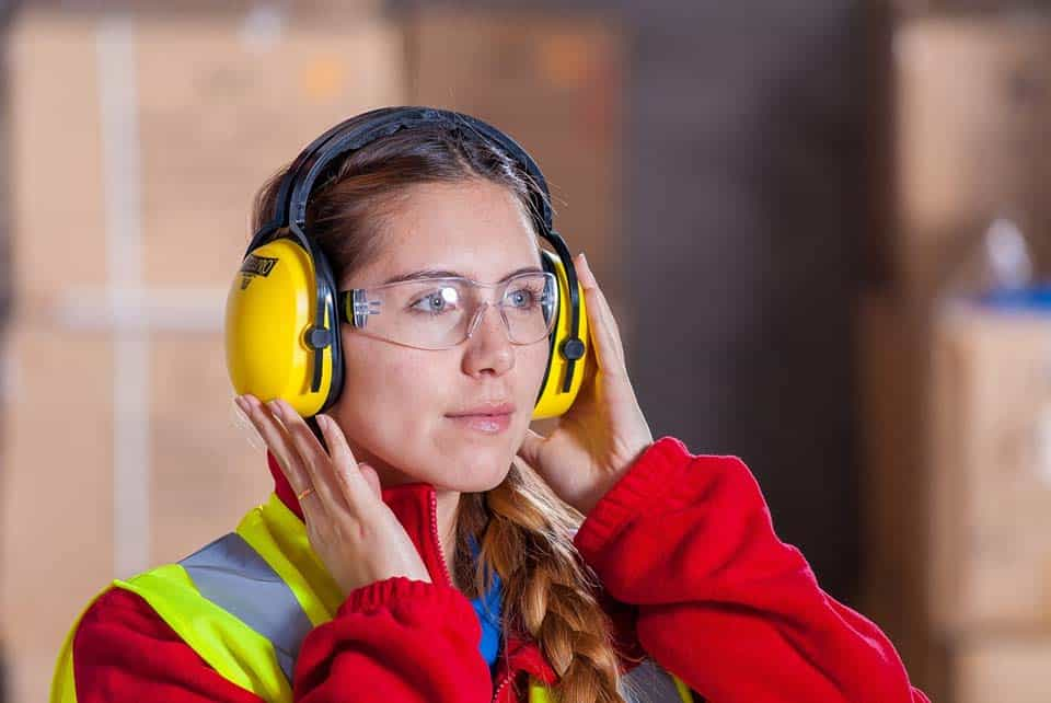 a construction worker wearing safety goggles and ear protectors