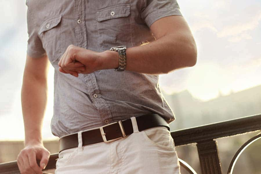 A man looking at his watch