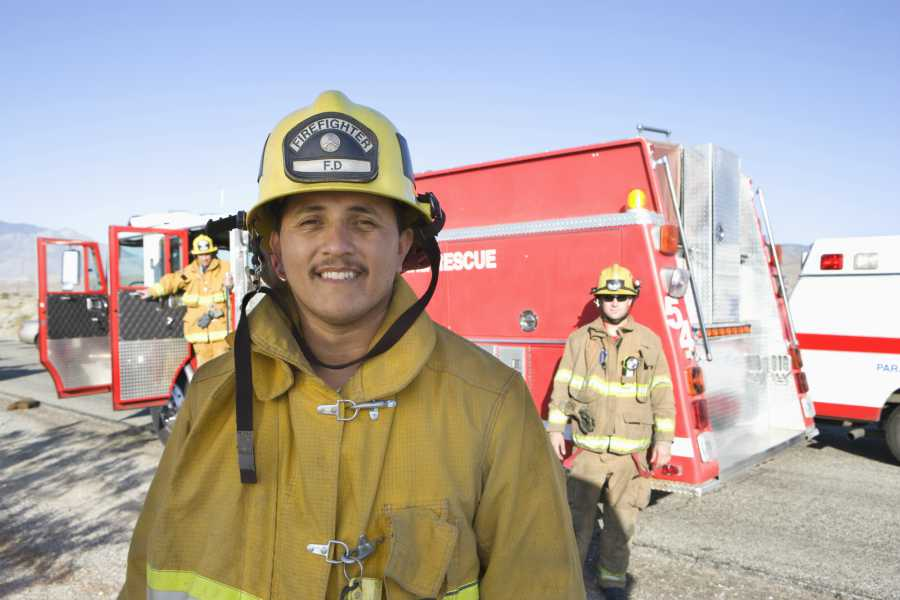 A firefighter wearing full protective fire safety gear
