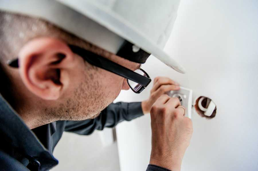 Building maintenance being conducted by an electrician