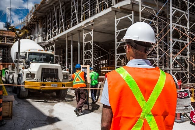 Construction worker in safety gear on construction site