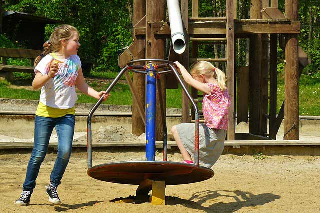 Children learning balance on a playground