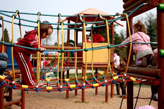Children playing on new Austin playground equipment