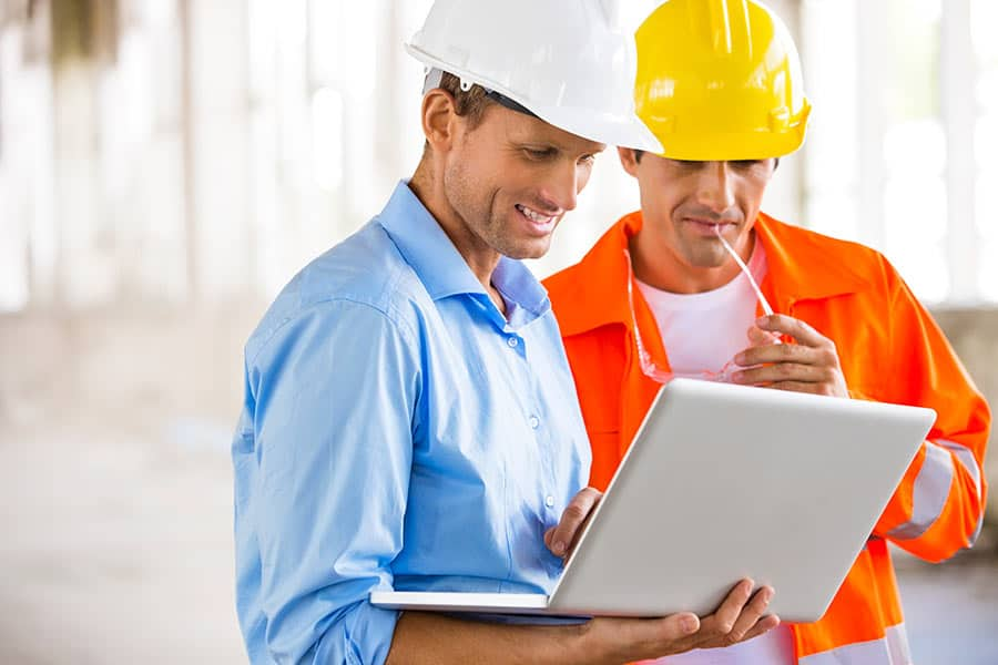 Construction men working on Laptop