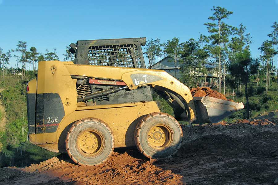 Skid Steer Loader Hauling Dirt