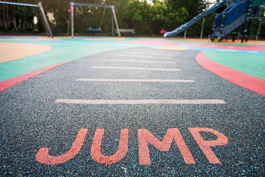 Playground with rubber surface installed by Austin contractors
