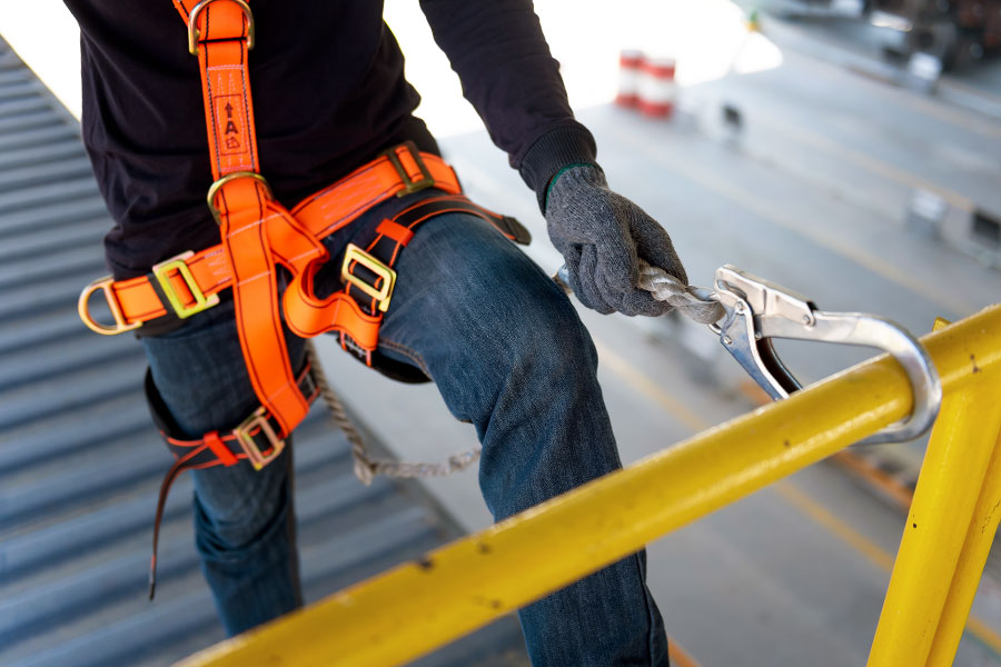 Construction worker following fall protection safety