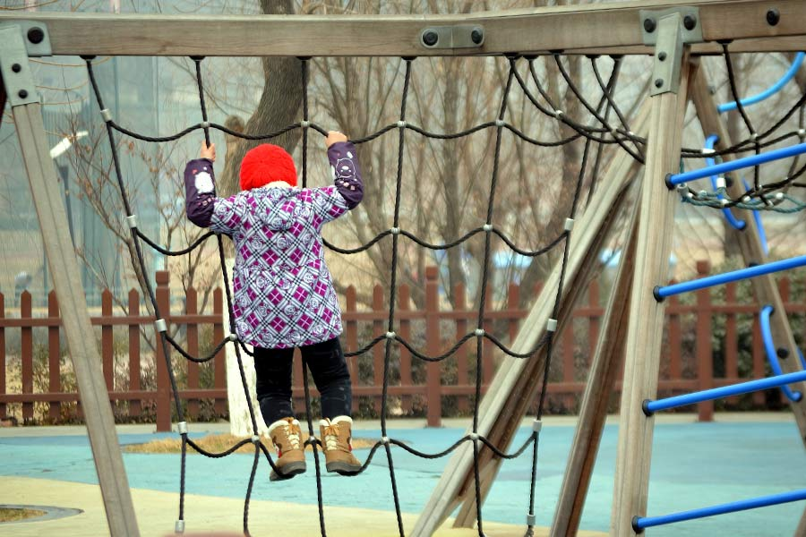 Child climbing on playground