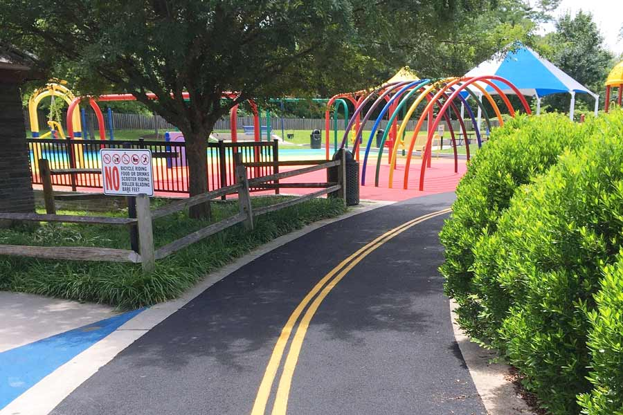 Playground with a wide lane leading to the play structures