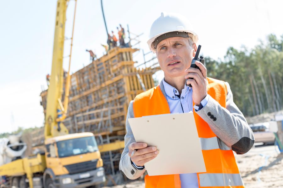 Construction worker talking on radio