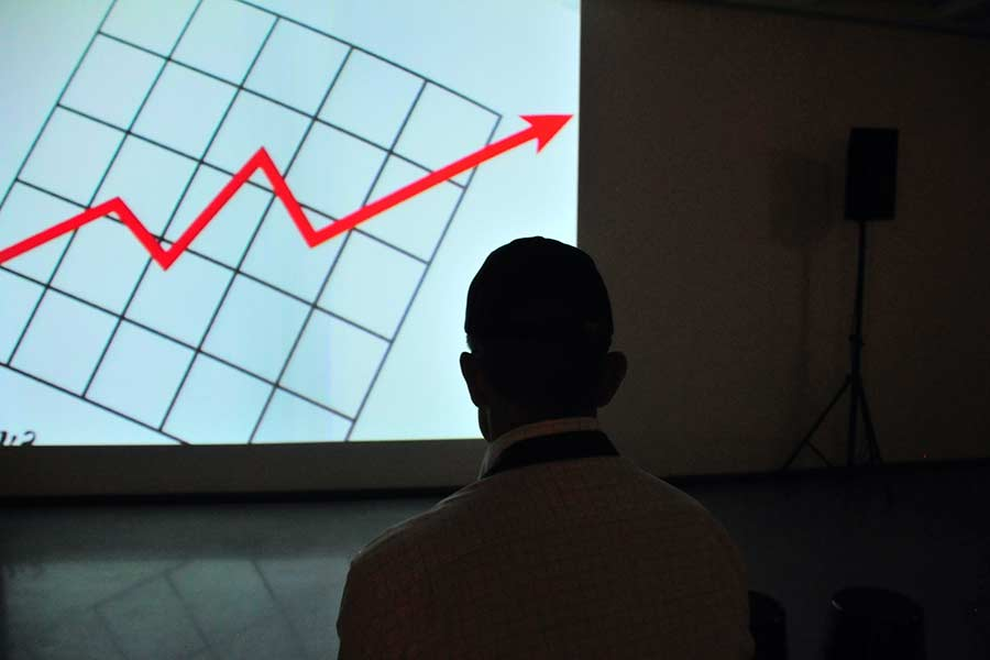 Man examining a chart on a projector
