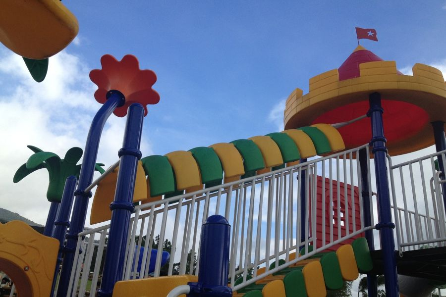 Photo of colorful stairs going up to playground slide