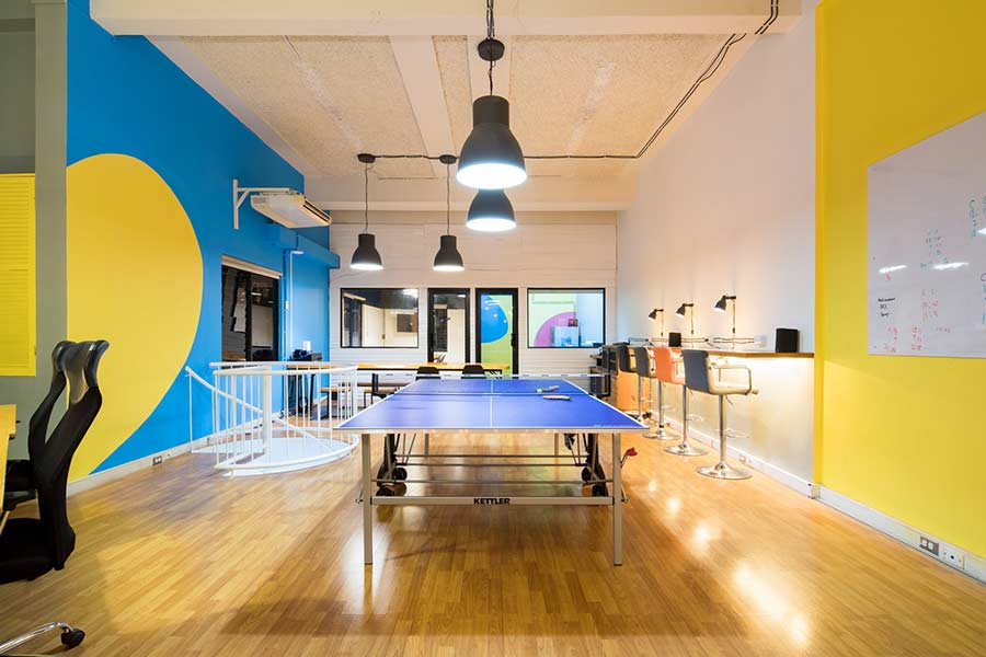A newly remodeled office with colorful walls and lots of natural lighting