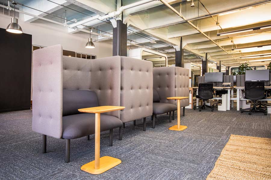 An open office with modular partitions to section off individual spaces