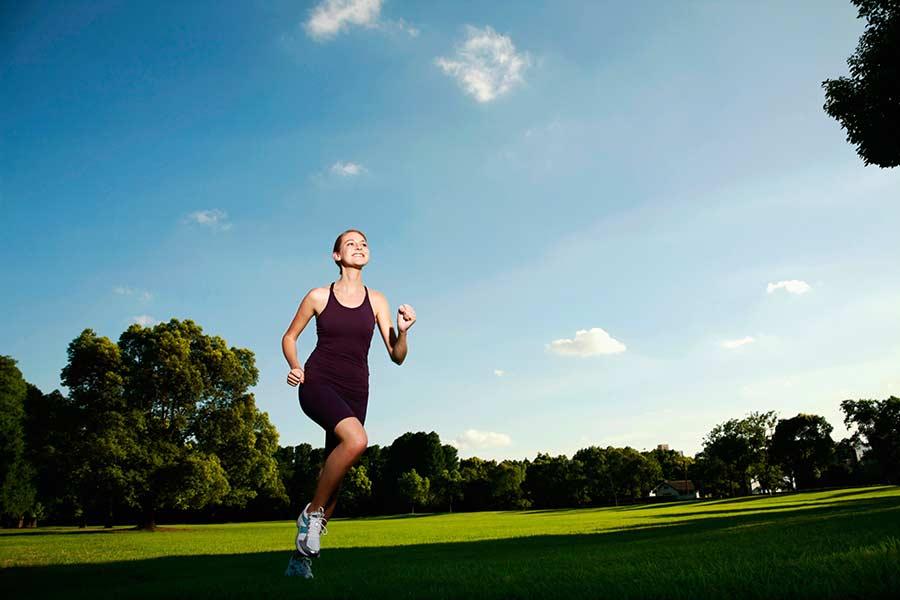 A woman jogging on a park trail