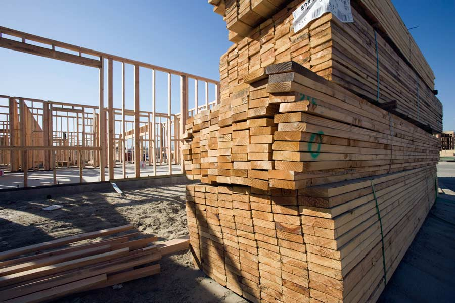 Reclaimed wooden planks on a construction site